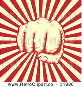 Vector Clip Art of a Retro Revolutionary Fist over Beige and Red Rays by AtStockIllustration