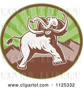 Vector Clip Art of Retro Attacking Elephant over a Circle with Mountains by Patrimonio