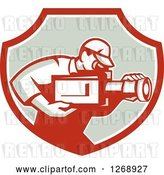 Vector Clip Art of Retro Cameraman Filming in a Red White and Taupe Shield by Patrimonio