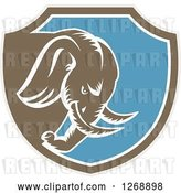 Vector Clip Art of Retro Cartoon Woodcut Charging Elephant in a Taupe Brown White and Blue Shield by Patrimonio