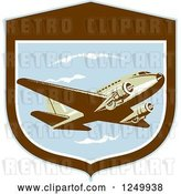 Vector Clip Art of Retro DC10 Propeller Airplane in a Shield by Patrimonio