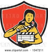 Vector Clip Art of Retro Female Asian Film Crew Worker Holding a Clapper in a Black White and Red Shield by Patrimonio
