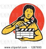 Vector Clip Art of Retro Female Asian Film Crew Worker Holding a Clapper over an Orange Circle by Patrimonio