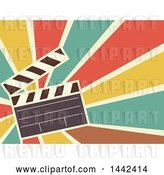 Vector Clip Art of Retro Flat Styled Clapperboard over Rays by BNP Design Studio