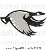 Vector Clip Art of Retro Flying Canadian Goose in Profile by Patrimonio