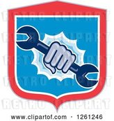 Vector Clip Art of Retro Hand Breaking Through a Shield with a Spanner Wrench by Patrimonio