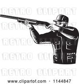 Vector Clip Art of Retro Hunter Holding a Rifle 2 by Patrimonio