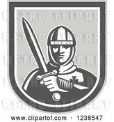 Vector Clip Art of Retro Knight Holding a Sword in a Shield by Patrimonio