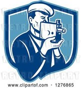 Vector Clip Art of Retro Male Camera Guy Filming in a Blue and White Shield by Patrimonio
