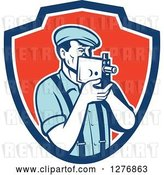 Vector Clip Art of Retro Male Camera Guy Filming in a Blue White and Red Shield by Patrimonio