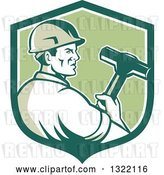 Vector Clip Art of Retro Male Construction Worker Holding a Sledgehammer in a Green and White Shield by Patrimonio
