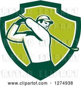 Vector Clip Art of Retro Male Golfer Swinging in a Green and White Shield by Patrimonio