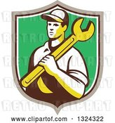 Vector Clip Art of Retro Male Mechanic Holding a Wrench and Emerging from a Taupe White and Green Shield by Patrimonio