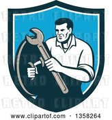 Vector Clip Art of Retro Male Mechanic Holding a Wrench and Shield Inside a Blue and White Shield by Patrimonio