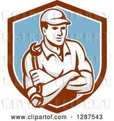 Vector Clip Art of Retro Male Mechanic Holding a Wrench, with Folded Arms, in a Brown White and Blue Shield by Patrimonio