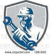 Vector Clip Art of Retro Male Mechanic Holding out a Wrench in a Gray Blue and White Shield by Patrimonio