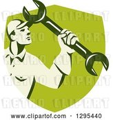 Vector Clip Art of Retro Male Mechanic Holding up a Wrench in a Green Shield by Patrimonio