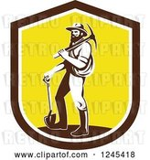 August 14th, 2018: Vector Clip Art of Retro Male Miner Carrying a Pickaxe and Standing with a Shovel in a Shield by Patrimonio