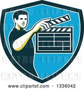 August 14th, 2018: Vector Clip Art of Retro Male Movie Director Holding up a Clapperboard in a Green White and Blue Shield by Patrimonio