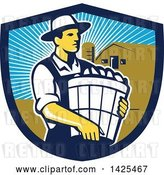Vector Clip Art of Retro Male Organic Farmer Carrying a Bushel of Harvest Produce, in a Shield Against a Barn and Silo by Patrimonio