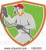 Vector Clip Art of Retro Male Painter Using a Spray Gun and Emerging from an Orange White and Green Shield by Patrimonio