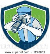 Vector Clip Art of Retro Male Photographer Taking Pictures in a Gray Blue White and Green Shield by Patrimonio
