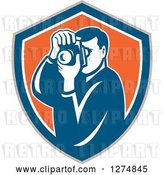 Vector Clip Art of Retro Male Photographer Taking Pictures in a Taupe Blue White and Orange Shield by Patrimonio