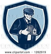 Vector Clip Art of Retro Male Photographer Using a Bellows Camera in a Blue and White Shield by Patrimonio
