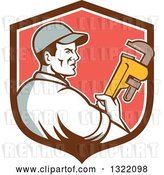 Vector Clip Art of Retro Male Plumber Holding a Monkey Wrench and Looking to the Side in a Brown White and Red Shield by Patrimonio