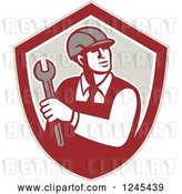 Vector Clip Art of Retro Male Worker Holding a Spanner Wrench in a Shield by Patrimonio
