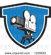 Vector Clip Art of Retro Movie Camera in a Blue Shield by Patrimonio
