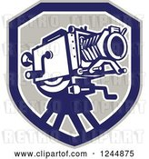 Vector Clip Art of Retro Movie Camera in a Shield by Patrimonio