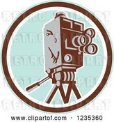 Vector Clip Art of Retro Movie Camera over a Pastel Blue and Brown Circle by Patrimonio