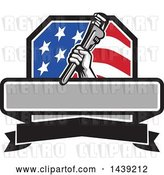 Vector Clip Art of Retro Plumber Hand Holding a Pipe Monkey Wrench in an American Crest, over a Banner with Text Space by Patrimonio