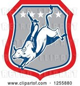 Vector Clip Art of Retro Rodeo Cowboy on a Bull in a Shield by Patrimonio