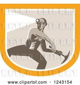 Vector Clip Art of Retro Shirtless Coal Miner Swinging a Pickaxe and Wearing a Light on a Hardhat in a Shield by Patrimonio