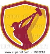 Vector Clip Art of Retro Silhouetted Male Demolition Worker Swinging a Sledgehammer in a Yellow Red and White Shield by Patrimonio