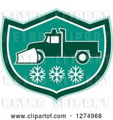 Vector Clip Art of Retro Snow Plow Truck over Snowflakes in a Tuquoise Green and White Shield by Patrimonio