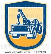 Vector Clip Art of Retro Tow Truck in a Yellow and Blue Shield by Patrimonio
