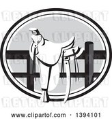 Vector Clip Art of Retro Western Saddle on a Fence, in a Grayscale Oval by Patrimonio