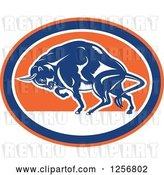 Vector Clip Art of Retro Woodcut Charging Angry Bison in a Blue Orange and White Oval by Patrimonio