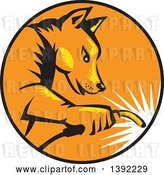 Vector Clip Art of Retro Woodcut Dingo Dog Welder in a Black Orange and Yellow Circle by Patrimonio