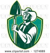 Vector Clip Art of Retro Woodcut Male Farmer Holding a Shovel in a Bgreen Shield by Patrimonio