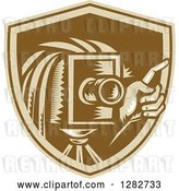 Vector Clip Art of Retro Woodcut Male Photographer Holding up a Finger and Using a Camera in a Brown Shield by Patrimonio