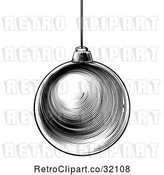 Vector Clip Art of Retro Woodcut or Engraved Suspended Christmas Bauble Ornament by AtStockIllustration