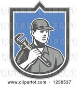 Vector Clip Art of Retro Woodcut Plumber Holding a Monkey Wrench in a Shield by Patrimonio