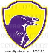 Vector Clip Art of Retro Woodcut Raven Crow in a Yellow Purple and White Shield by Patrimonio