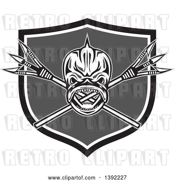 Vector Clip Art of Retro Tribal Skull of Dorado Dolphin Fish Mahi-mahi over Crossed Primitive Spears in a Black White and Gray Shield