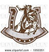 Vector Clip Art of Retro Rodeo Cowboy and Horse Leaping Through a Horseshoe Banner by Patrimonio